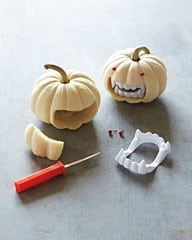 mini pumpkins with vampire teeth