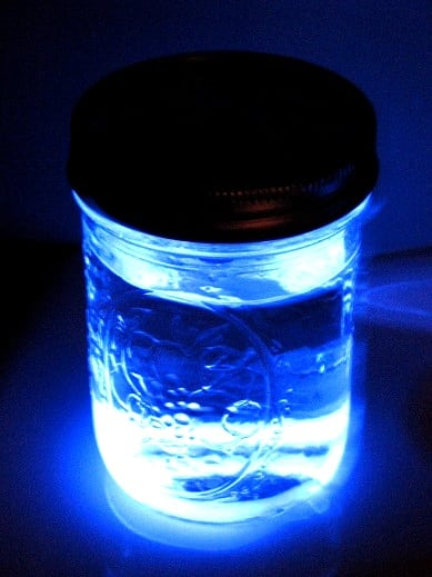jar with water and glow stick liquid inside