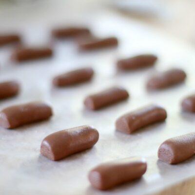 tootsie rolls on baking sheet