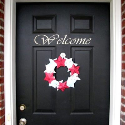 winter paper wreath on black door