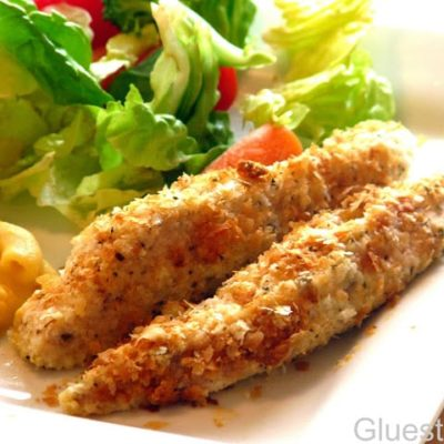 potato flake chicken strips with salad on plate