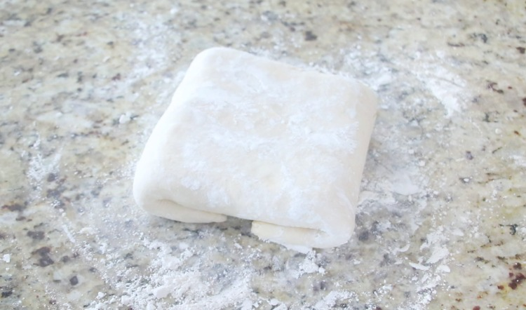 dough wrapped around square of butter
