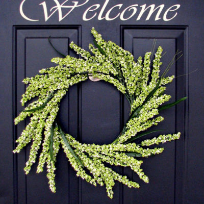 greenery wreath hanging on door
