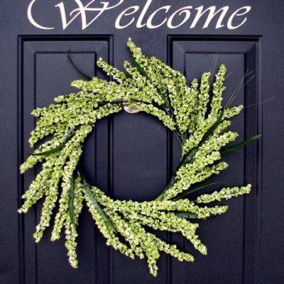 greenery wreath hanging on door