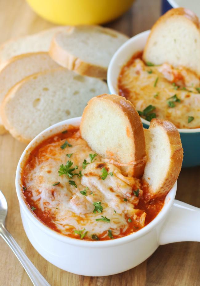 bowl of lasagna soup with baguette slices