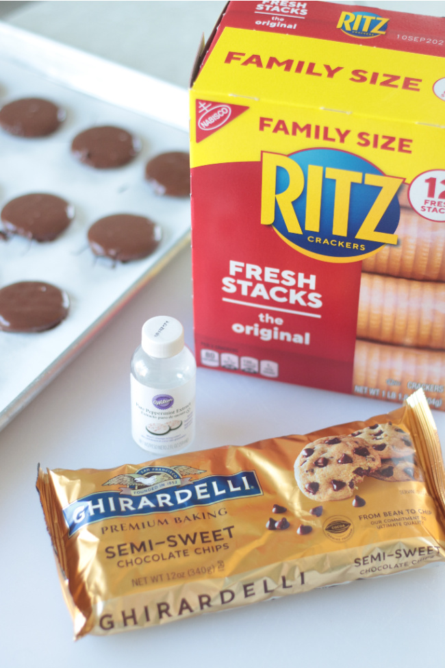 box of ritz crackers with bottle of peppermint extract and chocolate chips