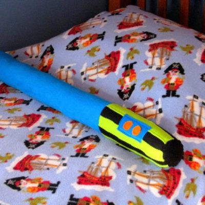 light saber bolster pillow on bed