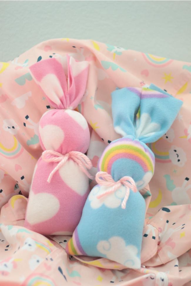 two stuffed fleece bunnies on bean bag chair