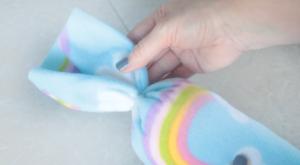 rubber band tied around sewn fleece tube