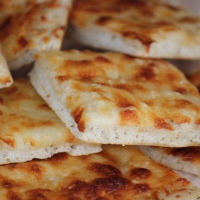 Focaccia bread cut into squares