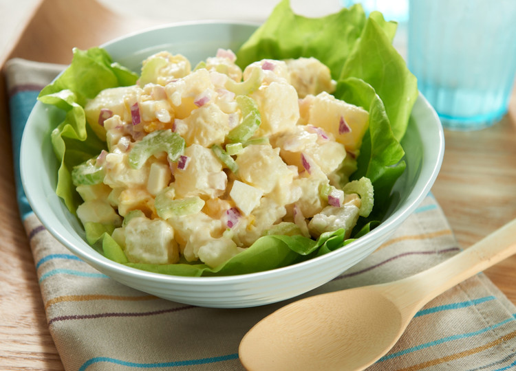bowl of potato salad with spoon