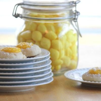 lemon cookies on stack of white plates
