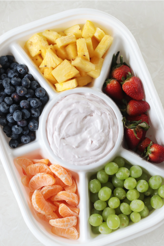 divided tray of fruit and fruit dip