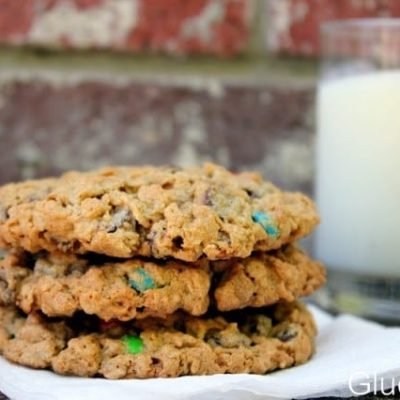 3 monster cookies stacked on napkin
