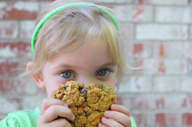 little girl holding monster cookie