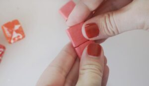 two red starburst candies pressed together