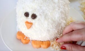 toasted coconut around base of chicken cake