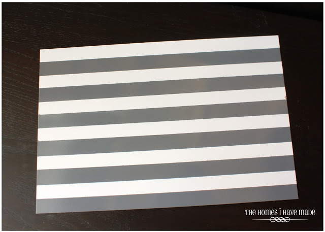 magnetic memo board covered in grey stripes