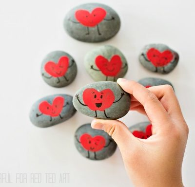 painted stones with red hearts