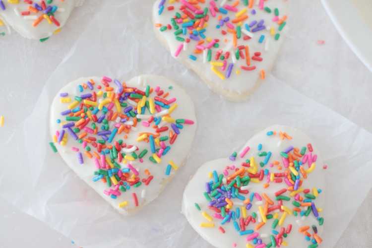 cookies dipped in frosting and sprinkled with sprinkles