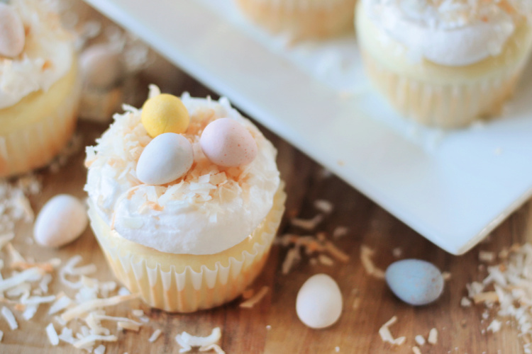 coconut cupcake with chocolate eggs on top