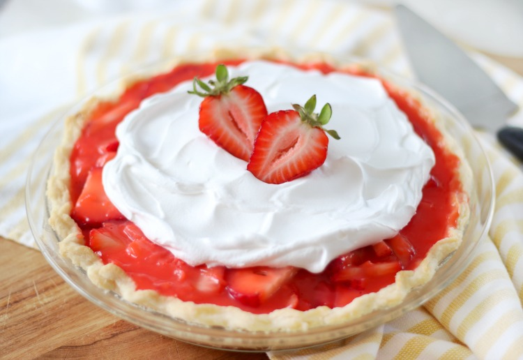 strawberry pie with whipped cream on top.