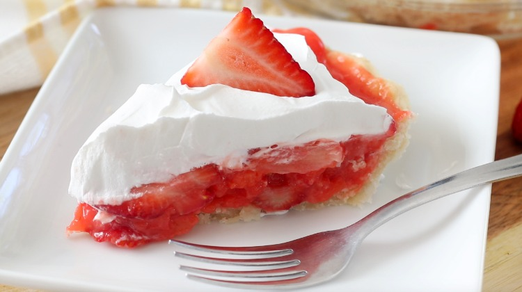 slice of pie on a white plate with fork