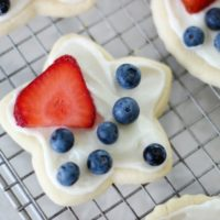 star shaped cookie with frosting and fruit