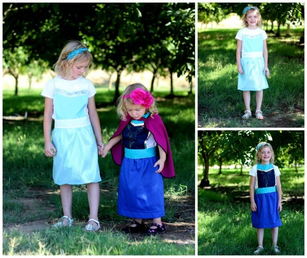 two little girls wearing Elsa and Anna aprons