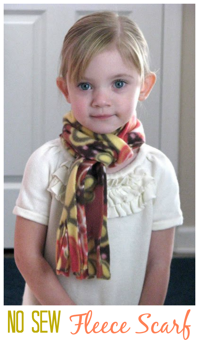 little girl wearing fleece scarf