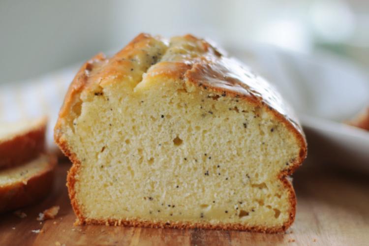 almond poppy seed bread on cutting board