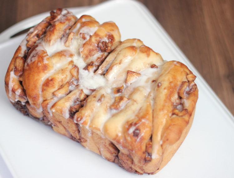 loaf of apple cinnamon bread on white platter