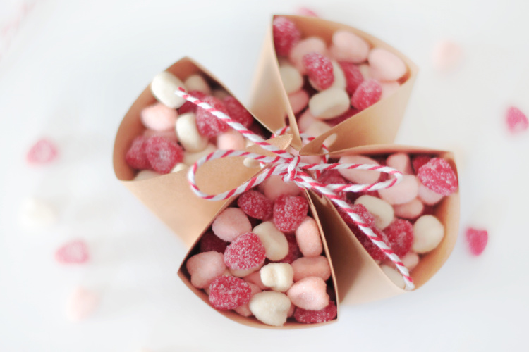 brown paper candy pouch filled with heart dummies