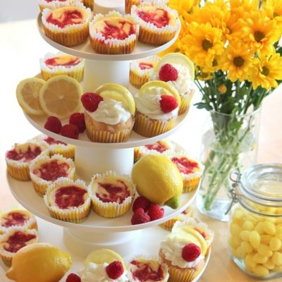 dessert stand with lemon cupcakes and mini raspberry cheesecakes