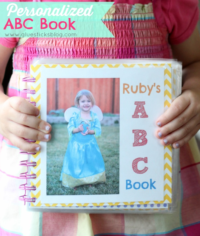 child holding personalized alphabet book
