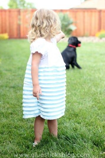 toddler in ruffled dress