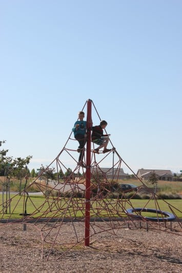 kids on playground climbing structure
