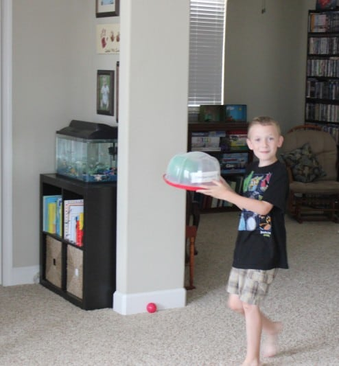 Phineas and Ferb Bucket List child holding green balloon that looks like a brain