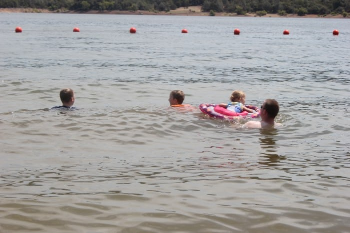 kids playing in lake summer bucket list activity