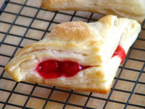 baked cherry turnover on cooling rack