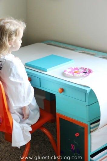 little girl at art desk