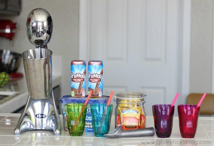 glass cups next to milkshake machine