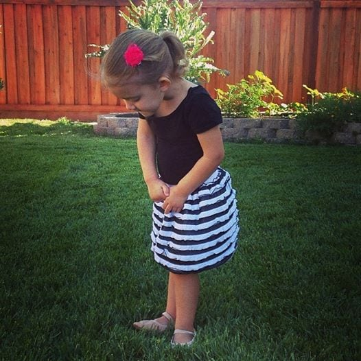 toddler in ruffle skirt