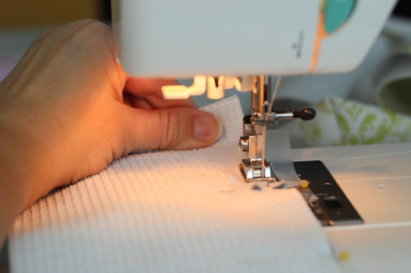 sewing machine stitching side of tote