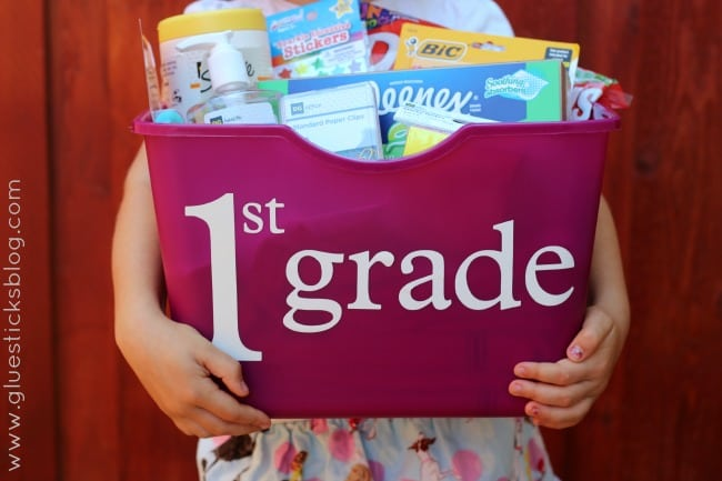 little girl holding school supplies tote