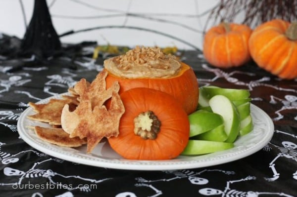 caramel dip inside pumpkin with apple slices for halloween classroom parties