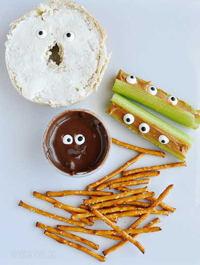 eyeball bagel, nutella with candy eyes and celery and peanut butter with eyeball candies