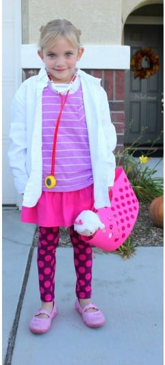 little girl wearing doc mcstuffins costume