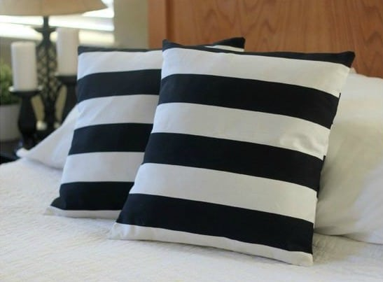 two striped throw pillows on bed