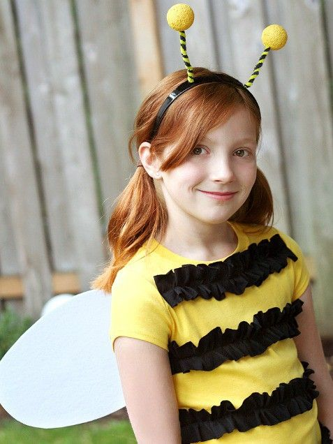 little girl wearing bumble bee costume